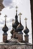 Domes of the old orthodox cathedral in Russia. The domes of five-domed white stone of the medieval cathedral of Archangel Michael in Yuriev-Polsky, Russia. View Royalty Free Stock Photography