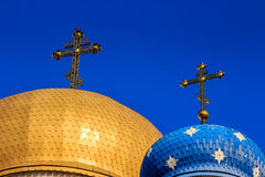 Domes of the Orthodox church with crosses. Two domes of the Orthodox church with golden crosses Stock Photo