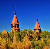 Domes of the Orthodox Church over the autumn taiga Royalty Free Stock Photo