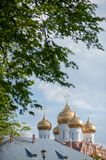 Domes of a religious building. Cathedral with silver domes against the sky stock photography