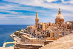 Domes and roofs of Valletta , Malta. View from above of roofs and church of Our Lady of Mount Carmel and St. Paul`s Anglican Pro-Cathedral, Valletta, Capital Stock Photos