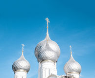 Domes of russian church against blue sky. Stock Images