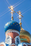 Domes of Russian orthodox church with cross against sky Stock Image
