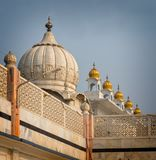 Domes of Sikh Temple glisten in sunshine in Delhi .tif. Domes of Sikh Temple glisten in sunshine in New Delhi, India stock image