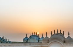Domes and spires of Nahargarh fort shot against the setting sun. Domes and spires of the Nahargarh fort in Jaipur shot against the setting sun. The hindu Rajput Royalty Free Stock Image