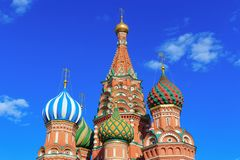 Domes of St. Basil`s Cathedral against blue sky Stock Photography