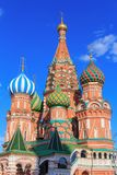 Domes of St. Basil`s Cathedral against blue sky Royalty Free Stock Photography
