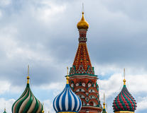 Domes of St. Basil's cathedral. Beautiful and decorative domes of St. Basil's cathedral on Red Square of Moscow, Russia, against the background of cloudy sky Stock Image