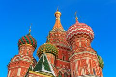 Domes of St. Basil`s Cathedral in the rays of the winter sun Stock Image