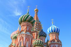 Domes of St. Basil`s Cathedral on Red square against blue sky on a sunny summer morning Stock Photo