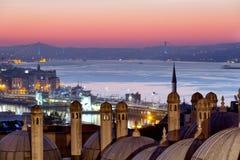 Domes of Suleymaniye Mosque. And the bridge through Bosphorus at sunrise, Istanbul Royalty Free Stock Images