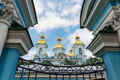 The domes of the temple in the frame of architectural elements. Nikolo-Epiphany Naval Cathedral in St. Petersburg, Russia stock photo
