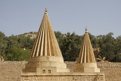 Domes of a Yezidi temple in Lalish, Iraq. Yezidi temple in Lalish, a holy village situated in North Iraq (Iraqi Kurdistan Stock Images