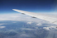 Domestic Airline Wing In Flight Over Mountains From Window Stock Photo