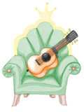 Domestic big classy armchair with musical instrument Royalty Free Stock Photography