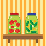Domestic billet. Cucumbers and tomatoes in cans. Pickled cucumbers and tomatoes. Royalty Free Stock Photo