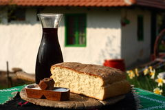 Domestic bread with wine and salt Royalty Free Stock Photography