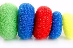 Domestic colorful sponge washer for dishes. In a row isolated over white Stock Photos