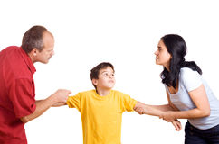 Domestic conflict. Hands of parents fighting over their son each pulling him their way stock photos
