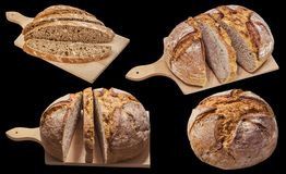 Domestic Dark Multi Grain Bread Loaves Isolated on Black Background.  stock photos