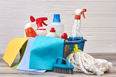 Domestic disinfect products in basket. Set of chemicals for housework. Cleaning home service royalty free stock images