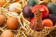 Domestic eggs. Eggs in hay and woven basket Stock Image