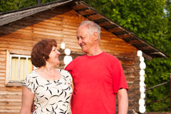 Domestic elderly pair on nature Royalty Free Stock Photos