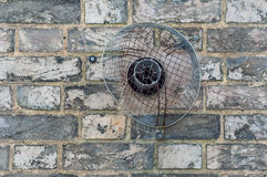 Domestic exhaust vent on a brick wall royalty free stock images
