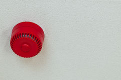Domestic fire alarm sound alert red round ceiling Stock Image