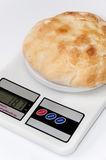 Domestic flat bread on a kitchen digital scale Royalty Free Stock Photography