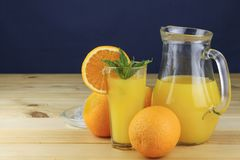 Domestic fresh orange juice in a glass jar. Stock Photos