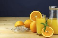 Domestic fresh orange juice in a glass jar. Stock Photos