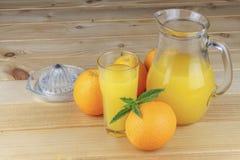 Domestic fresh orange juice in a glass jar. Royalty Free Stock Image
