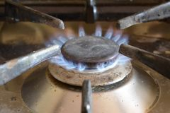Domestic gas ring with blue flame Stock Photo