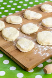Domestic homemade raw dough with flour on the wooden board Royalty Free Stock Photos