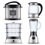 Domestic Kitchen appliances. Set of Original Electric Domestic Kitchen appliances and supplies. Food Steamer and Blender. Glass Kettle and Pressure Cooker Royalty Free Stock Photo