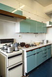 Domestic Kitchen 1960s. Domestic blue Kitchen with kitchen utensil's  built and designed in the 1960s Royalty Free Stock Image