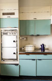 Domestic Kitchen 1960s period. Domestic blue Kitchen with kitchen utensil's  built and designed in the 1960s Stock Image
