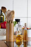 Domestic Kitchen with worktop, Cooking Spoon Rack and ceramic ho Stock Photo