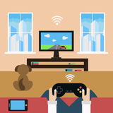 Domestic leisure with help of modern technology Royalty Free Stock Image