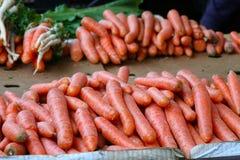 Domestic organic carrots on marketplace Royalty Free Stock Photos