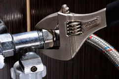 Domestic plumbing connections. Plumber Installation Hoses. Royalty Free Stock Images