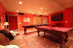 Domestic pool room. Red billiard or pool tables in luxurious modern room with lighting royalty free stock photography