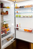 Domestic refrigerator full of a variety of foods Royalty Free Stock Photos