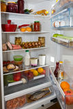 Domestic refrigerator full of a variety of foods Stock Photography