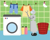 Domestic Robot washing and hanging clothes to dry. Royalty Free Stock Image