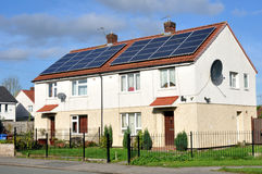 Domestic Roof Mounted Solar Panels. On residential houses Royalty Free Stock Photo