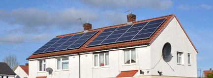 Domestic Roof Mounted Solar Panels. On residential houses Royalty Free Stock Photography