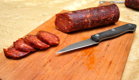 Domestic sausage cut up on the table while the sun shines. Novi Sad, Serbia Royalty Free Stock Images