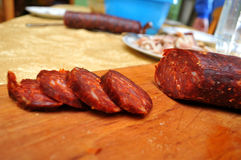 Domestic sausage cut up on the table while the sun shines. Novi Sad, Serbia Royalty Free Stock Photography